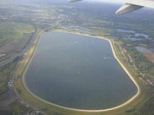 Grassy banked, sheep-grazed Wraysbury Reservoir next to Heathrow.